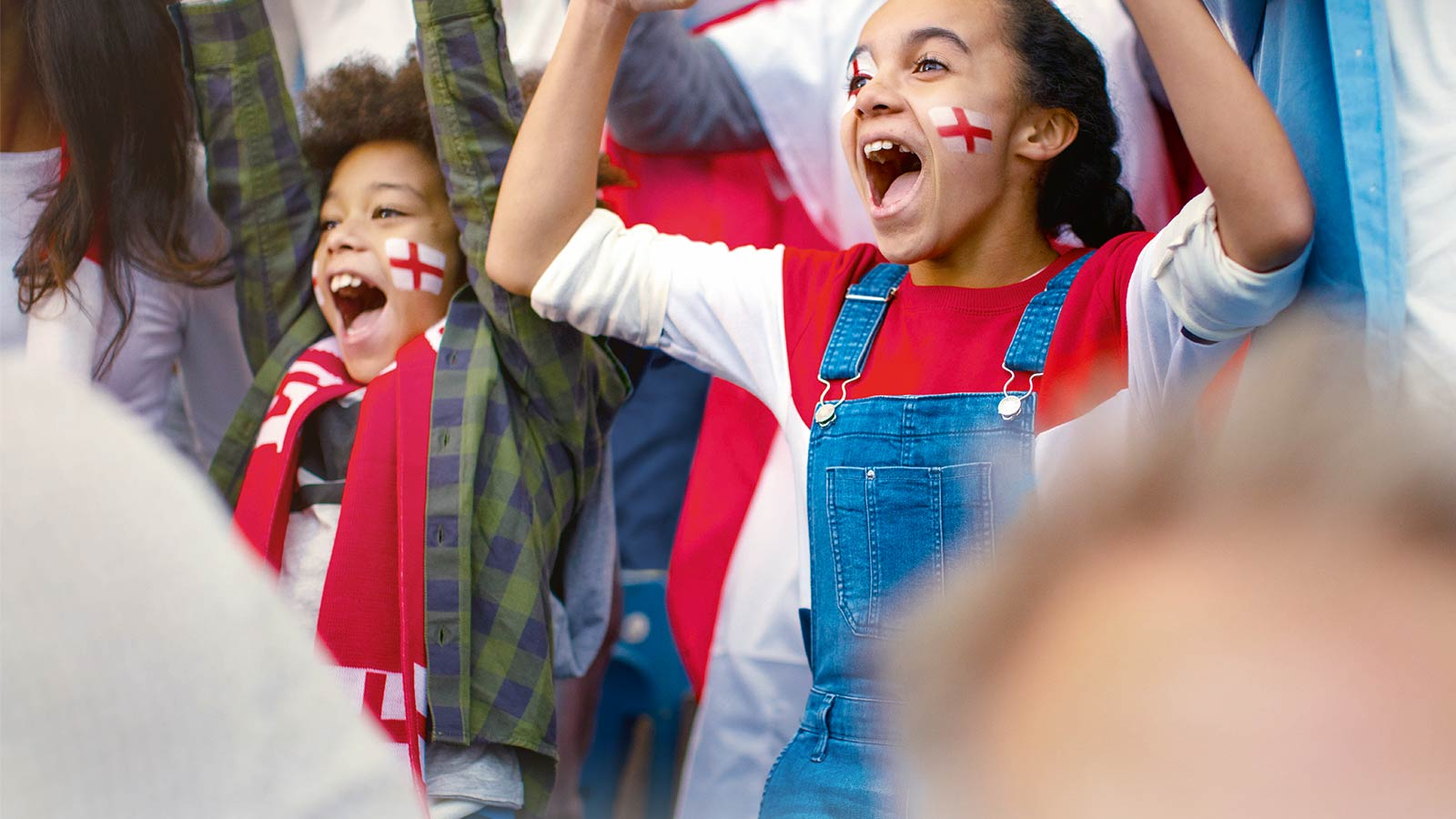 Kids cheer on the England football team at the FIFA Women's World Cup.