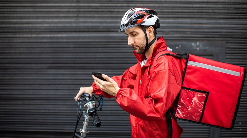 Grafika ilustracyjna - dostawca na rowerze